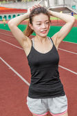 Chinese woman on sports track preparing — Stock Photo