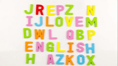 Alphabet magnets being taken away to form I Love English, stop motion — Stock Video