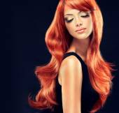 Girl with beautiful and shiny red hair — Stock Photo