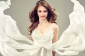 Girl model in a white wedding dress — Stock Photo