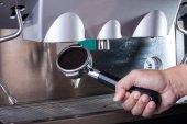 Barista hand with espresso coffee machine — Stock Photo