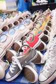 A pair of sneakers on ground and beautiful sort of row. selectiv — Stock Photo