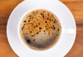 Top view of a cup of black coffee on wooden — Stock Photo