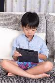 Boy playing with digital tablet — Стоковое фото