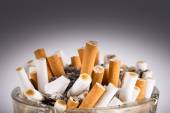 A dirty ashtray with cigarette ash and butts — Stock Photo