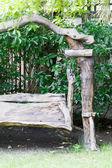 Wooden swing in backyard garden — Stock Photo