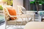 Orange pillow on wooden chair — Stock fotografie