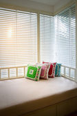 Colorful pillows on modern daybed — Stock Photo