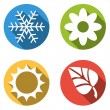 Collection of 4 isolated flat colorful buttons for 4 seasons ico — Stock Vector #72421425