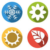 Collection of 4 isolated flat colorful buttons for 4 seasons ico — Stock Vector