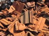 Photo of pile of broken bricks and roof tiles — Stock Photo