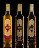 Three bottles of Mabrouka Authentic Arack on black background — Stock Photo