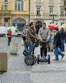 Young men traveling on the Segways in Prague — Stock Photo