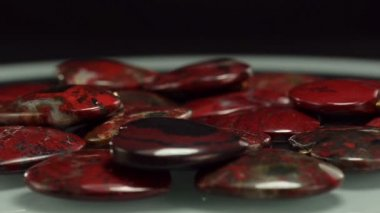 Rotating brecciated jasper carved hearts — Stock Video