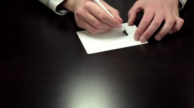Hands write the word contract — Stock Video