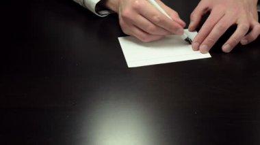 Hands writing the words top secret — Стоковое видео