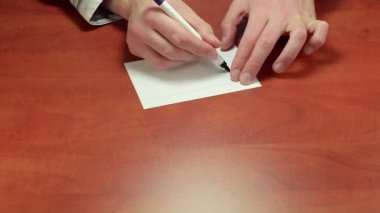 Writing Fake on note paper — Vídeo stock