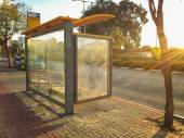 Bus shelter flooded by sunset — Stock Photo