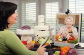 Nutrition professional giving advice senior woman — Stock Photo