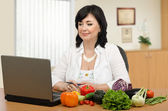 Nutrition professional working online — Stock Photo