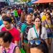 Tourists and locals shop at Chatuchak Weekend Market — Stock Photo #63986547