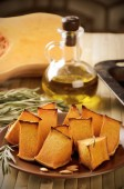 Toning effect baked pumpkin, rosemary and olive oil on a kitchen — Stock Photo