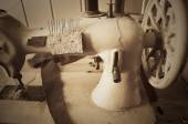 Handwheel old sewing machine. horizontal, sepia, monochrome — Stock Photo