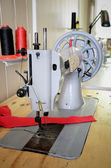 Old sewing machine in the sewing studio. vertical — Stock Photo
