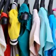 Multicolored womens clothing hanging on the hanger verticalcloth — Stock Photo #75532559