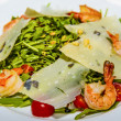 Juicy portions of grilled tiger prawns  with cheese and greens. — Stock Photo #66393497