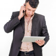 Businessman with a phone and a palmtop computer.  — Stock Photo #70938021