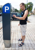 Young man paying for parking — Stock Photo