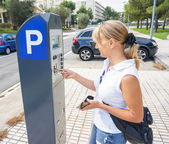 Young woman paying for parking — Stock Photo