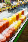 Juice plastic cups in different colors. — Stock Photo