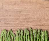 Bunch of  asparagus on wooden table — Stock Photo