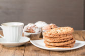 Cup of coffee with tasty  cookies and muffins — Stock Photo