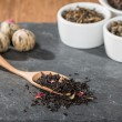 Dry tea leaves in wooden spoons — Stock Photo #65053627