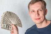 Biznes człowiek wyświetlanie stron widzących dolarów — Zdjęcie stockowe