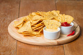 Nachos with various sauces — Stock Photo