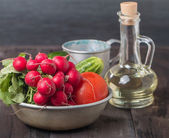 Fresh radishes, tomatoes, cucumbers and olive oil — Stock Photo