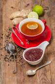 Cup of  tea with ginger,   raspberry jam and lemon — Stock Photo