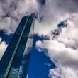 Постер, плакат: Clouds over the modern John Hancock Building in Boston Massachu