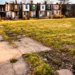 Cracked sidewalk and abandoned row houses in Baltimore, Maryland — Stock Photo #52581787