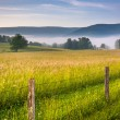 Farm field and distant mountains on a foggy morning in the rural — Stock Photo #52585895