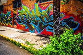 Colorful graffiti on a brick building in Little Five Points, Atl — Stock Photo