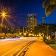 Palm trees and buildings along Dade Boulevard at night, in Miami — Stock Photo