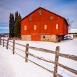 Red barn and fence in a snow-covered farm field in rural Adams C — Stock Photo #52599165