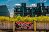 Graffiti on wooden fence in front of waterfronts condos in Point — Stock Photo