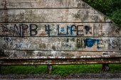 Guardrail and graffiti on a wall, near Spring Grove, Pennsylvani — Stock Photo