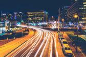 Long exposure of traffic moving past modern buildings on Pratt S — Stock Photo